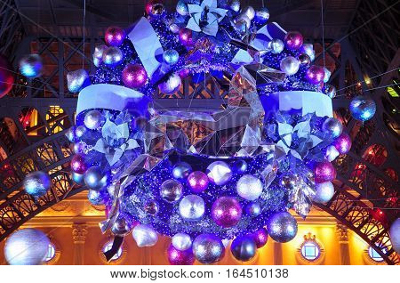 A lighted christmas wreath on a holiday display on the island of macau china lit up at night in Asia.