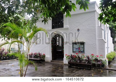 The exterior of the historic landmark protestant church called the Morrison Chapel on a rainy day on the island of macau china.