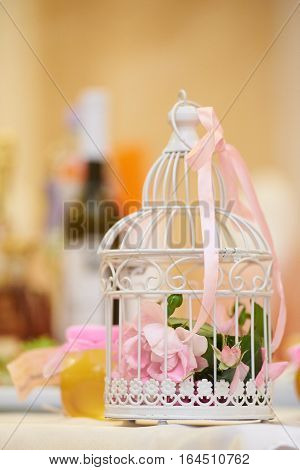 Pink Flowers In Beautiful Vintage Birdcage.
