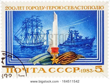 MOSCOW RUSSIA - January 08 2017: A stamp printed in USSR (Russia) shows old and modern warships devoted to the 200th Anniversary of Sevastopol circa 1983
