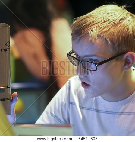 LAS VEGAS, NEVADA,DECEMBER 29. The Discovery Children's Museum on December 29, 2016, in Las Vegas, Nevada. A Boy Uses a Microscope at the Discovery Children's Museum in Las Vegas, Nevada.