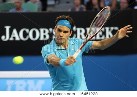 MELBOURNE - JANUARY 27: Roger Federer hits a backhand in his win over Nikolay Davydenko during a quarter final match in the 2010 Australian Open on January 27, 2010 in Melbourne