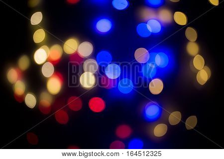 bokeh, dark , colourful light, blue, yellow and red