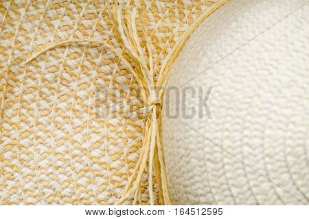 A fragment of a straw hat closeup Abstract summer background
