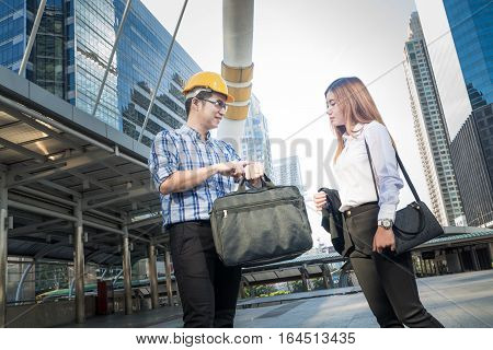 Businessman Or Architect And Secretary Or Assistant Talking While Looking To Watch