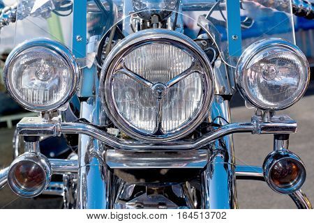 Headlight of a modern motorcycle with chrome details