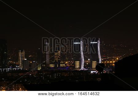 IZMIR, TURKEY - DECEMBER 31, 2016: Landscape of the skyscrapers of izmir at night with Folkart  towers construction. Night view.