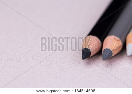 gray, black and white pencil on beige pastel paper coarse grain grunge texture. Copy space. Place for text.