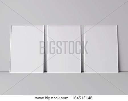Three white blank frames in a bright room. 3d rendering