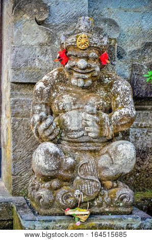 ancient god statues with smile at Bali Indonesia