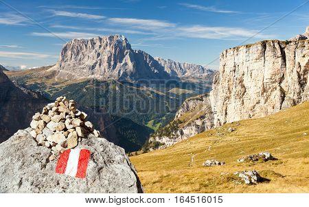 Langkofel with tourist sign Italian dolomities mountains