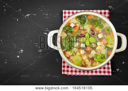 A bowl of minestrone soup on the table