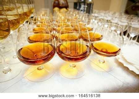 glasses with cognac or brandy on event catering