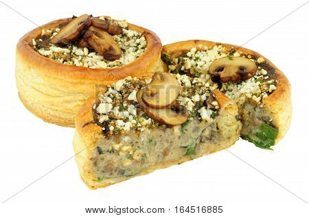 Mushroom and spinach filled vol au vents isolated on a white background