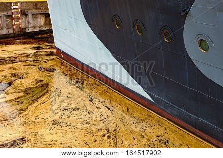 Oil spill from the ship - Texture of crude oil spill on the water.