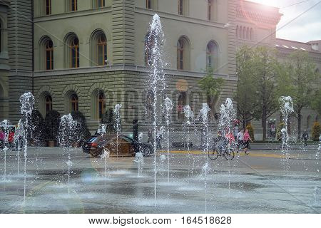 Very beautiful fountain jets spurting out of the ground