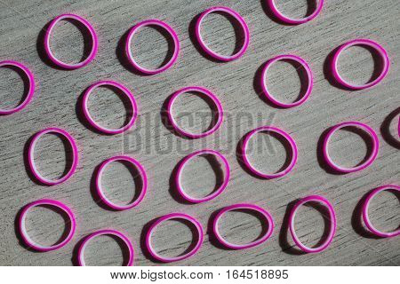 colored rubber bands on wooden background conceptual idea