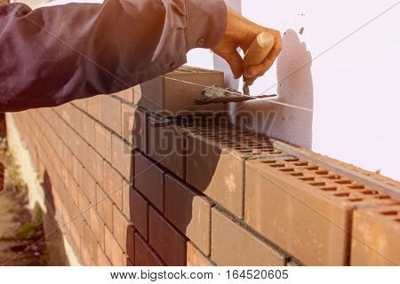 Bricklayer lays the mortar for laying brick. construction work poster