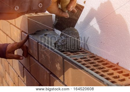 Bricklayer lays the mortar for laying brick. construction work