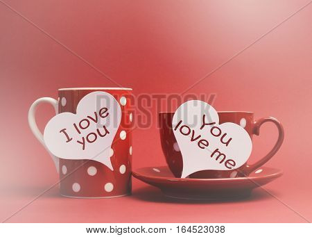 "Valentine ""i Love You"" And ""you Love Me"" Messages Written On Heart Tag Signs On Red Polka Dot Mug, A"