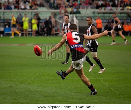 MELBOURNE - APRIL 25: Essendon's Brent Stanton kicks during Collingwood's massive win over Essendon - April 25, 2010 in Melbourne, Australia.