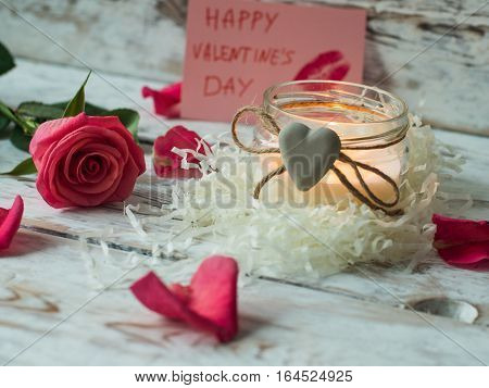 Burning candle on vintage wooden table. Valentine's Day and Mother's Day background.