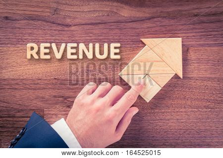 Increase revenue concept. Businessman plan revenue growth represented by arrow.
