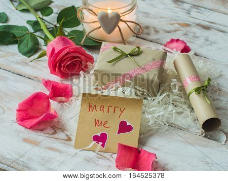 Will you marry me words written on paper, love card. Valentine's Day postcard.