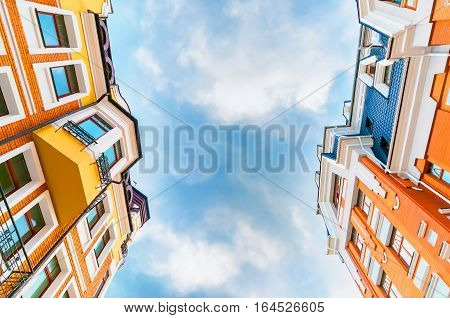 Panoramic and perspective wide angle view of two new tall residential building with clear sky and clouds