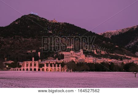 Gubbio medieval village under pink sunset, Umbria