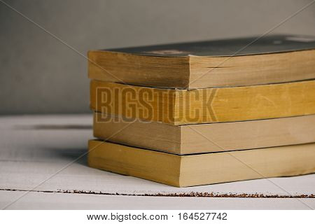 Old Books Background. Books on wooden shelf. Copy space.