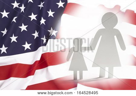 Single mother with daughter in United States paper figures