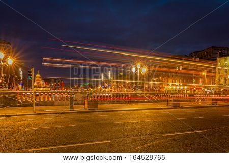 Dublin, Ireland - 8 Jan 2017: Evening traffic in the city center, Dublin. Traffic lights at embankment of Liffey River