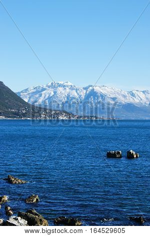 Snow-covered mountains and the Adriatic Sea (Montenegro)