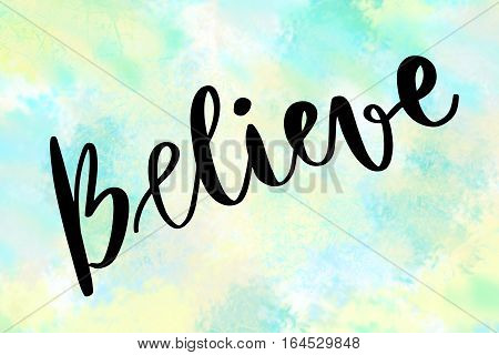 Believe handwritten message over blue painted background