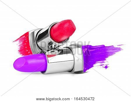 Two open lipsticks with smears isolated on white background