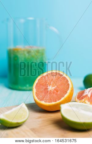 Citrus fruits. Oranges, limes and lemons. Set of sliced citrus on wooden table background with copy space