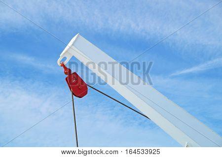Pulley block. Detail of crane on passenger cruise tall ship sailing .