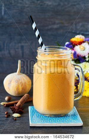 Healthy pumpkin spice smoothie with cream and caramel
