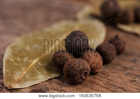 The grains or granules of peppers on wood and