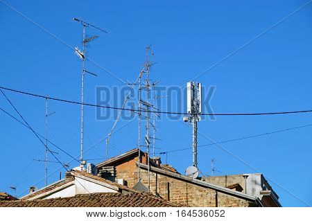 television antenna on roof with blue sky.