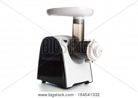 Meat Grinder Electric With The Light Gray Plastic Case, A Tray For Meat And A Metal Pipe, On A White