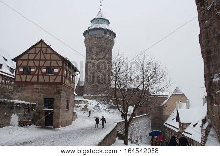 Nuremberg Germany - December 30 2014: view of the Nuremberg Castle Deep well small building with gable roof and Sinwell Tower in winter time on December 30 2014 in Nuremberg Germany.