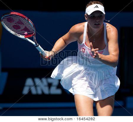 MELBOURNE - JANUARY 23: Caroline Wozniacki of Denmark in her fourth round win over Anastasija Sevastova of Latvia in the 2011 Australian Open on January 23, 2011 in Melbourne, Australia
