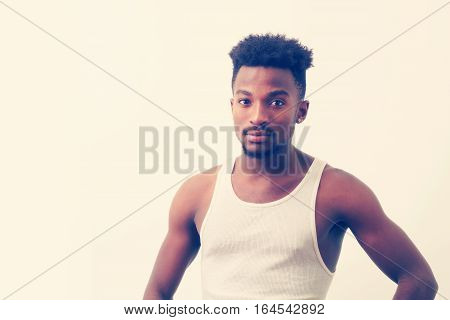 young man undershirt white background studio shot