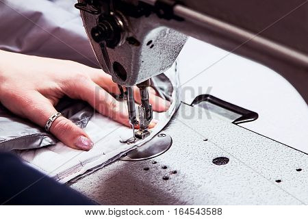 sewing machine with the processing in progress