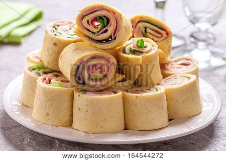 Tortilla roll ups with ham, cream cheese and lettuce