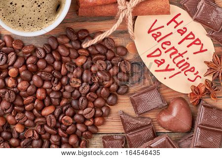 Coffee beans and chocolates. Coffee on Valentine's Day. Confectionery as perfect gift.