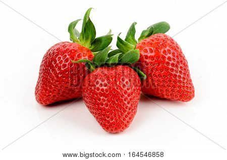 Strawberries with leaves isolated on white background