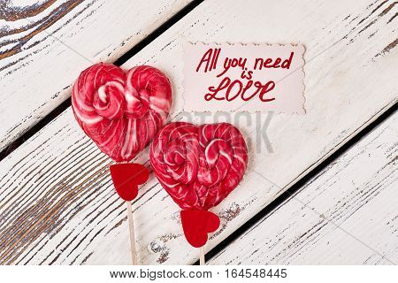Lollipops and red hearts. All you need is love. Cherish what you have. poster